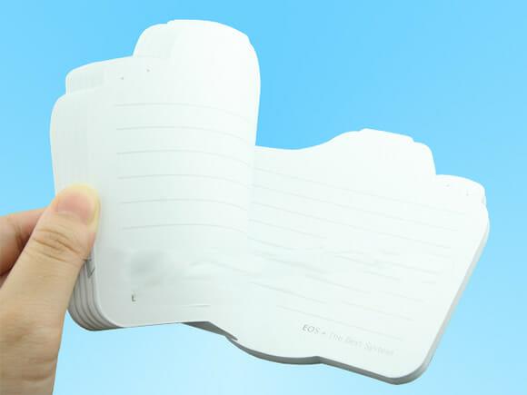 Um bloco de anotações que imita câmera digital.