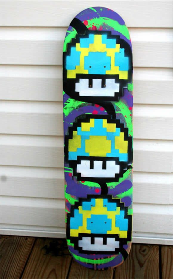 1UP - Um deck de skate geek.