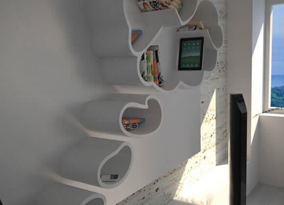 Dream - Uma prateleira de livros em forma de balão de pensamento.