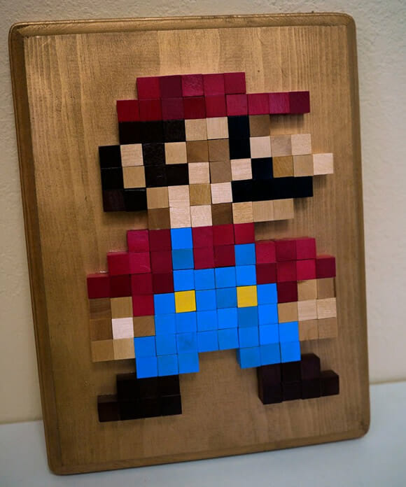 Quadros 8-bit em alto relevo do Super Mario e de outros personagens clássicos