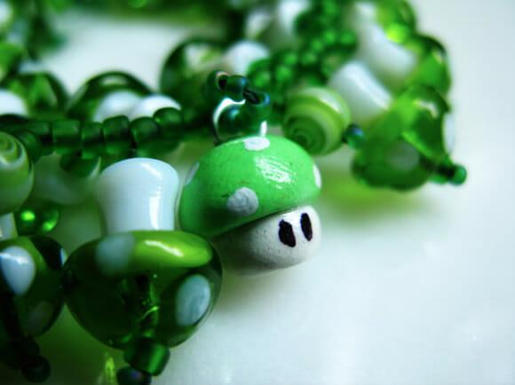 Pulseira cheia de cogumelos 1UP do Super Mario