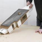 Artista transforma aspiradores de pó em miniaturas de casas que sugam a sujeira para seu interior