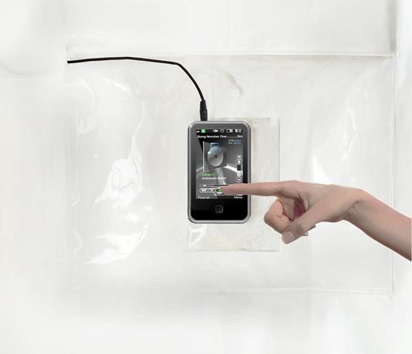 Com a cortina ShowerTunes dá pra usar seu smartphone ou tablet enquanto você toma banho!