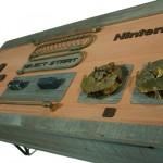 Decoração geek com a mesa de centro em forma do controle do Nintendinho 8-bits estilo steampunk
