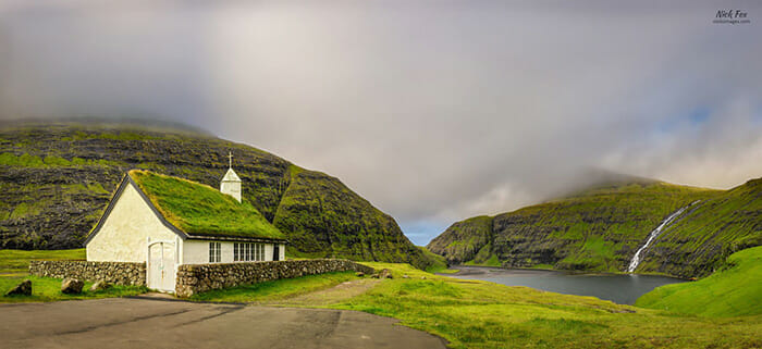Village church and a lake in Saksun, Faroe Islands, Denmark